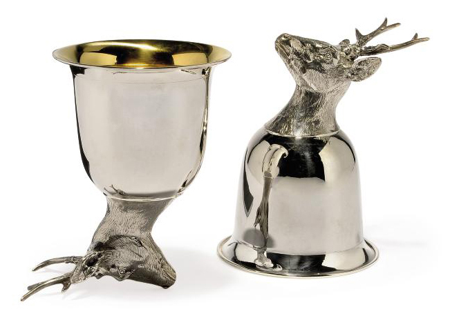 A PAIR OF CONTINENTAL METALWARE STAG'S HEAD STIRRUP CUPS