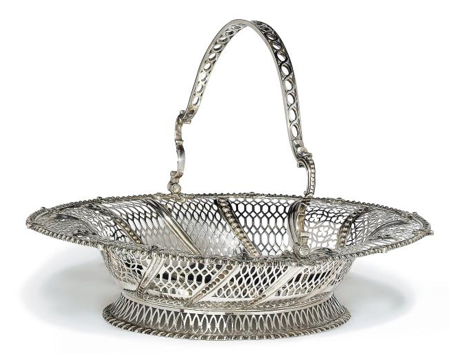 A GEORGE III OVAL SILVER SWING-HANDLED CAKE BASKET