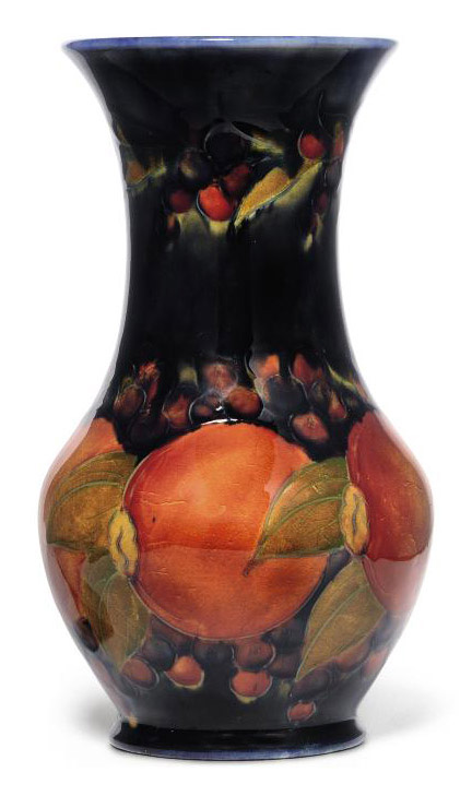 A Moorcroft Pomegranate Vase 20th Century Fruit And Vegetables