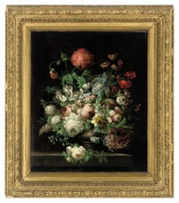 Peonies, tulips, morning glory, a passion flower and other flowers, in a vase, on a stone ledge