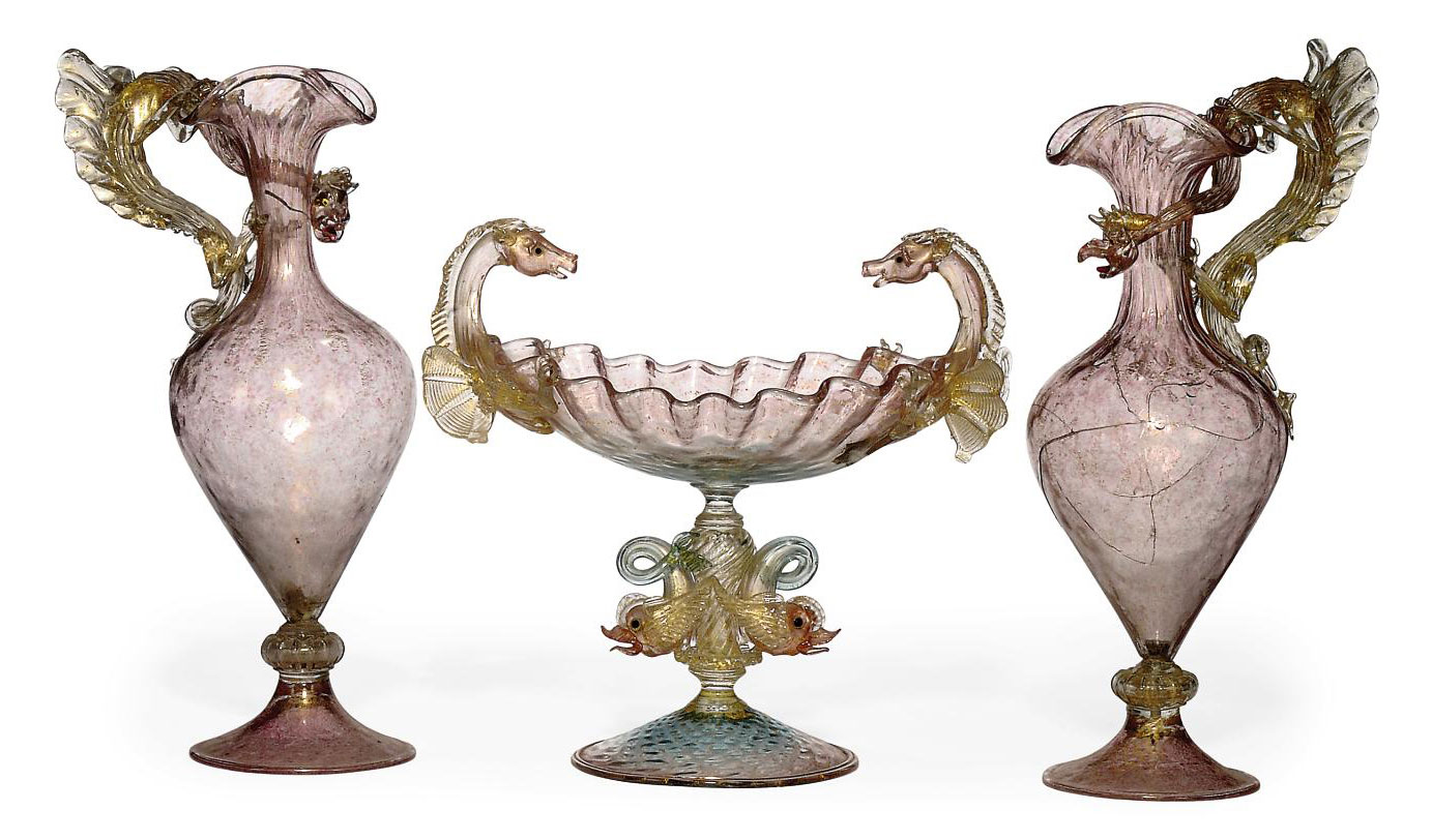 A PAIR OF VENETIAN TRANSLUCENT PINK AND GILT EWERS AND A CENTRE-BOWL SIMILAR