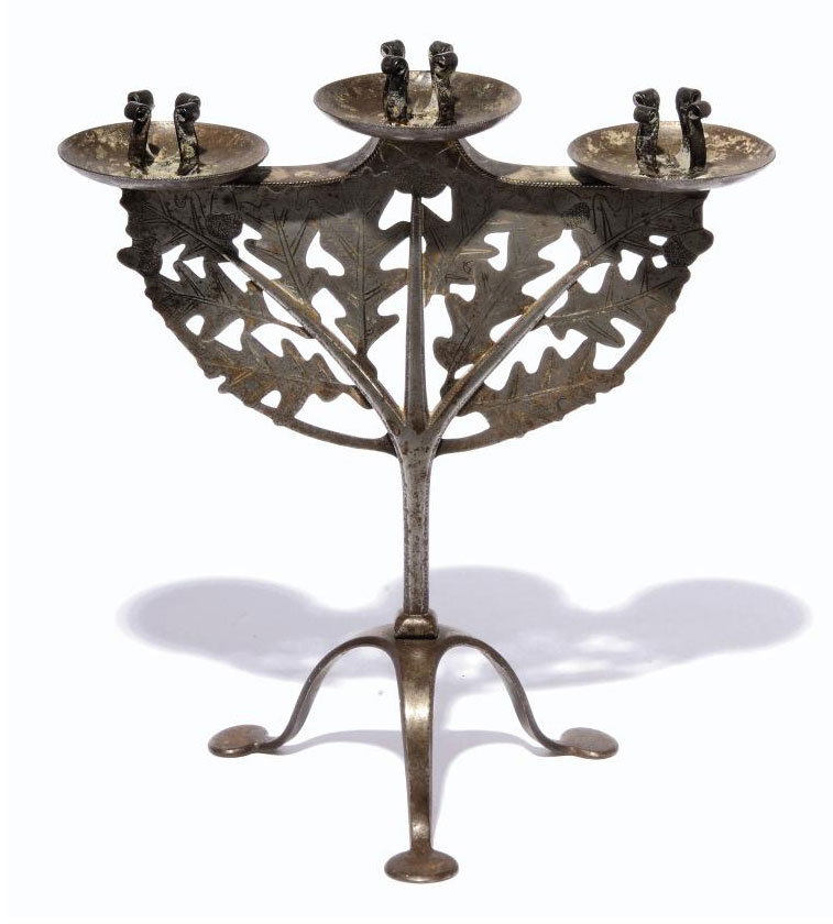 A POLISHED STEEL RUSSELL & SONS 'LYGON' CANDELABRUM DESIGNED BY GORDON RUSSELL CIRCA 1925