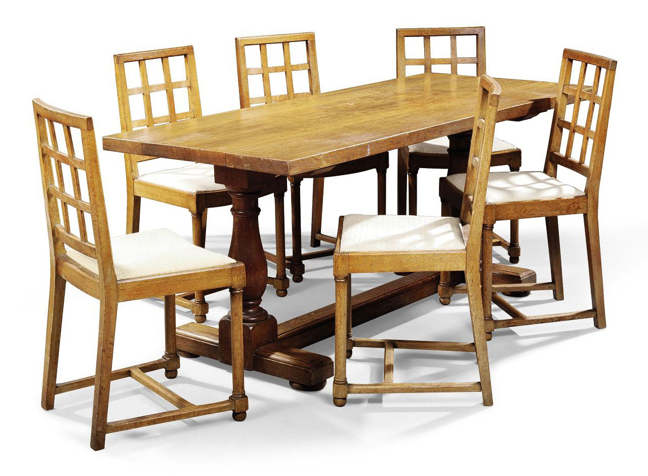 A HEAL & SON LTD OAK DINING TABLE AND CHAIRS