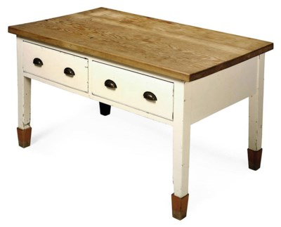 A CREAM-PAINTED KITCHEN TABLE
