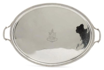 A GEORGE III SILVER OVAL TWO-H