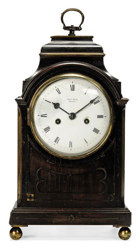 A REGENCY MINIATURE BRASS-MOUNTED EBONISED STRIKING EIGHT DAY TABLE CLOCK
