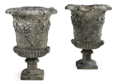 A PAIR OF LARGE STONE URNS