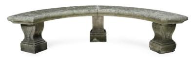 A LIMESTONE CURVED GARDEN BENC