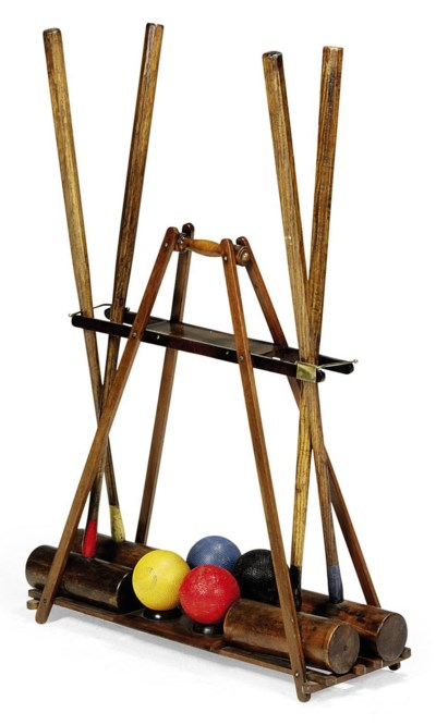 A MAHOGANY CROQUET STAND AND S