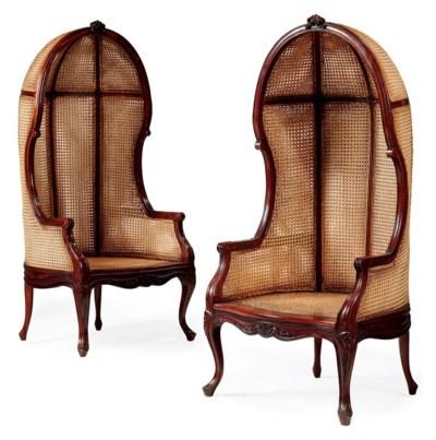 A Pair Of Carved Mahogany And Caned Porters Chairs Of