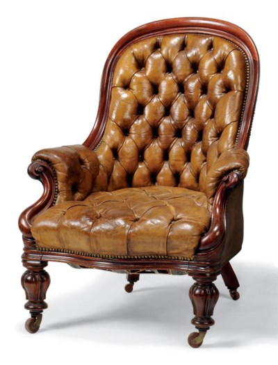 A MID-VICTORIAN CARVED MAHOGAN