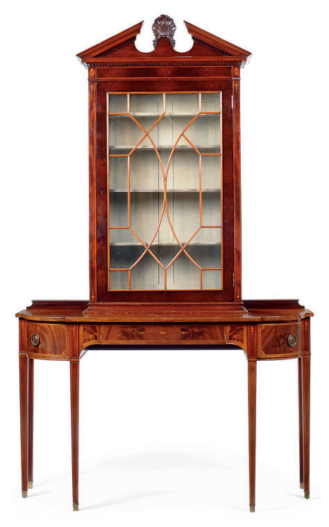 A MAHOGANY CROSSBANDED CABINET ON STAND
