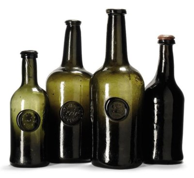 FOUR GREEN-TINTED WINE-BOTTLES