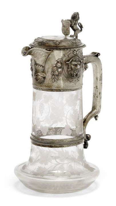 A VICTORIAN ETCHED GLASS CLARET JUG WITH SILVER-GILT MOUNTS
