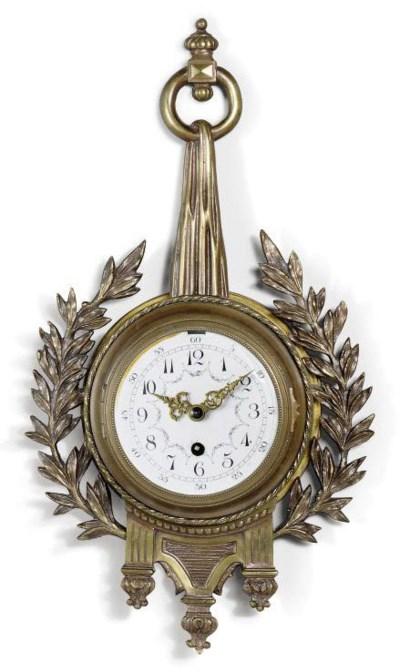 A FRENCH BRASS TIMEPIECE CARTE