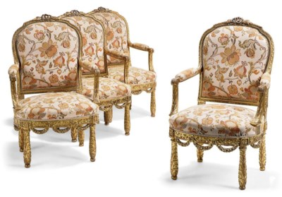 A SET OF FOUR FRENCH CARVED GI