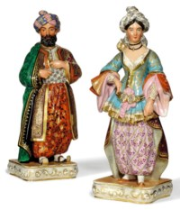 A PAIR OF FRENCH PORCELAIN FIGURAL FLASKS