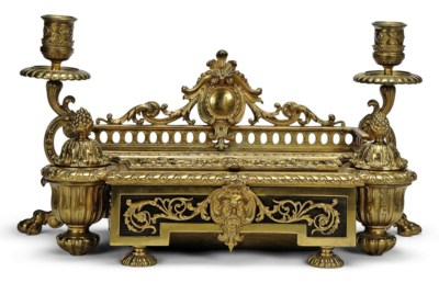 A FRENCH GILT-BRONZE AND EBONY