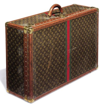 AN ALZER SUITCASE IN MONOGRAM
