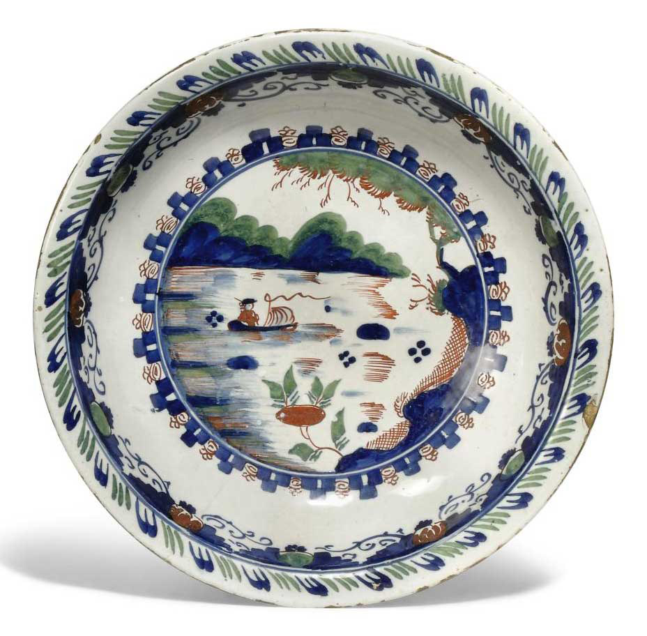 AN ENGLISH DELFT BLUE, RED AND GREEN DEEP DISH
