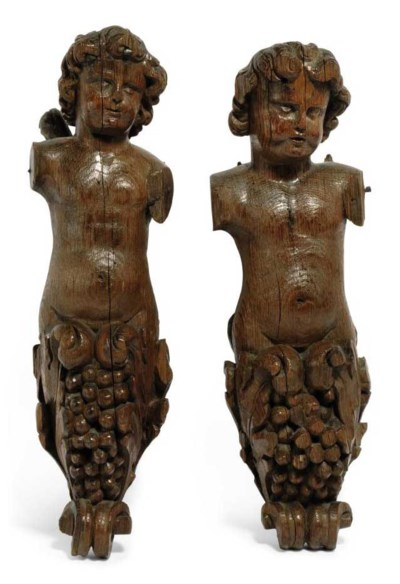 A PAIR OF CARVED OAK ANGEL CAR