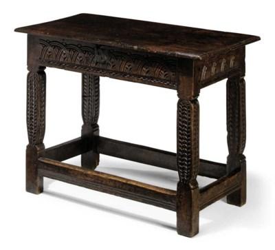 A LATE ELIZABETHAN OAK TABLE O