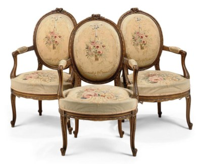 A SET OF THREE CARVED BEECH FA