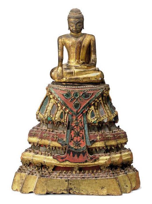 A GILT WOOD FIGURE OF BUDDHA WITH STAND