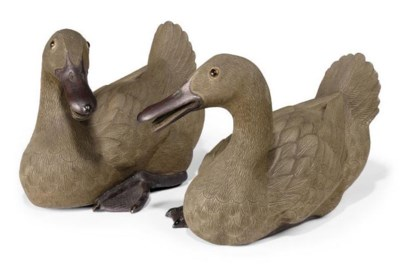 A PAIR OF CHINESE BROWN STONEW
