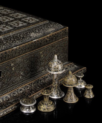 AN INDIAN BRASS, SILVERED AND