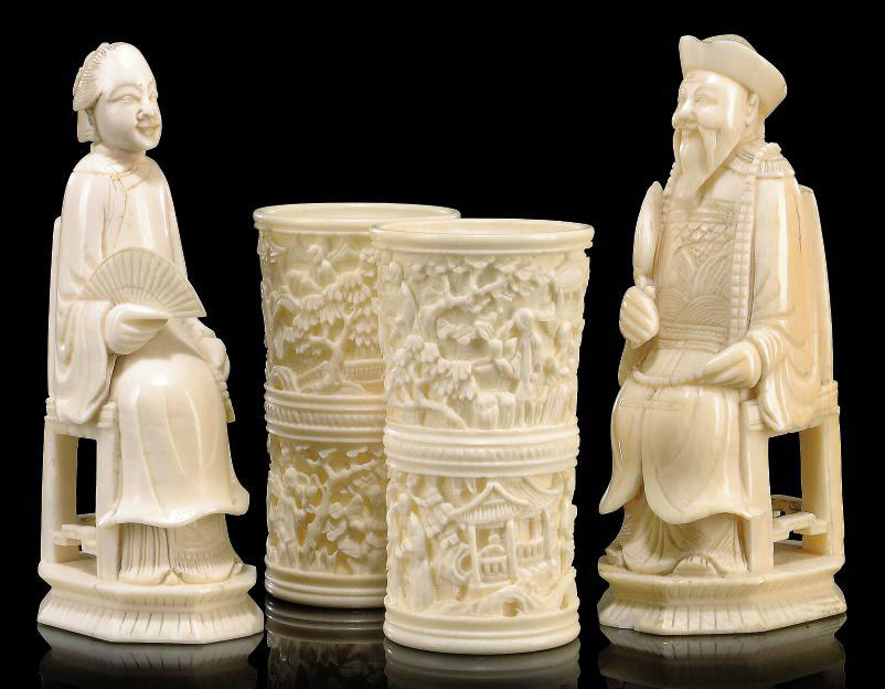 TWO CHINESE CARVED IVORY SEATED FIGURES