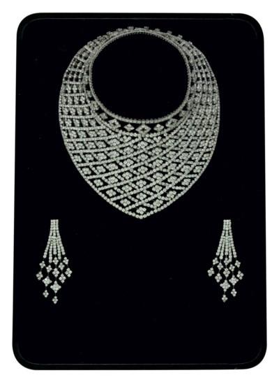 A DIAMOND DEMI-PARURE, BY ELIE