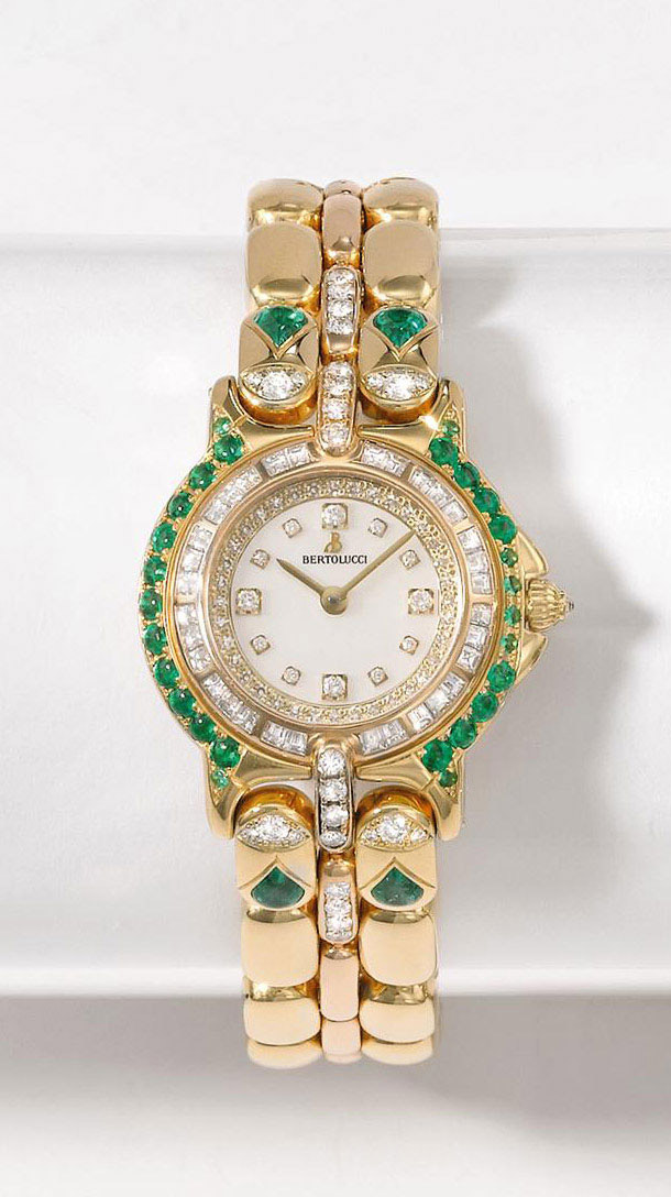 BERTOLUCCI  LADY'S YELLOW GOLD AND EMERALD-SET QUARTZ BRACELET WATCH WITH MOTHER-OF-PEARL DIAL