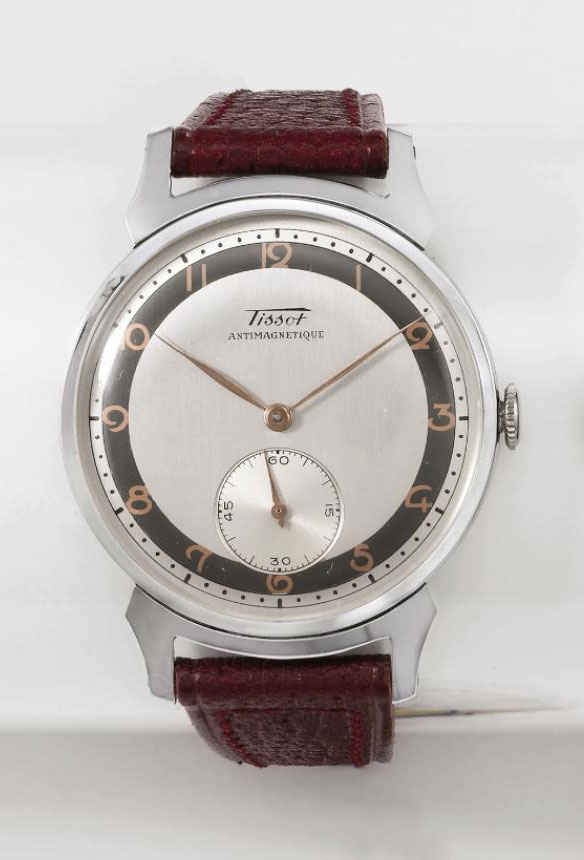 Tissot. An attractive stainless steel antimagnetic wristwatch with two-tone silvered dial