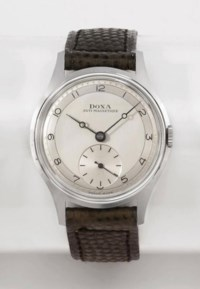 Doxa. An attractive stainless steel wristwatch with two-tone silvered dial and box