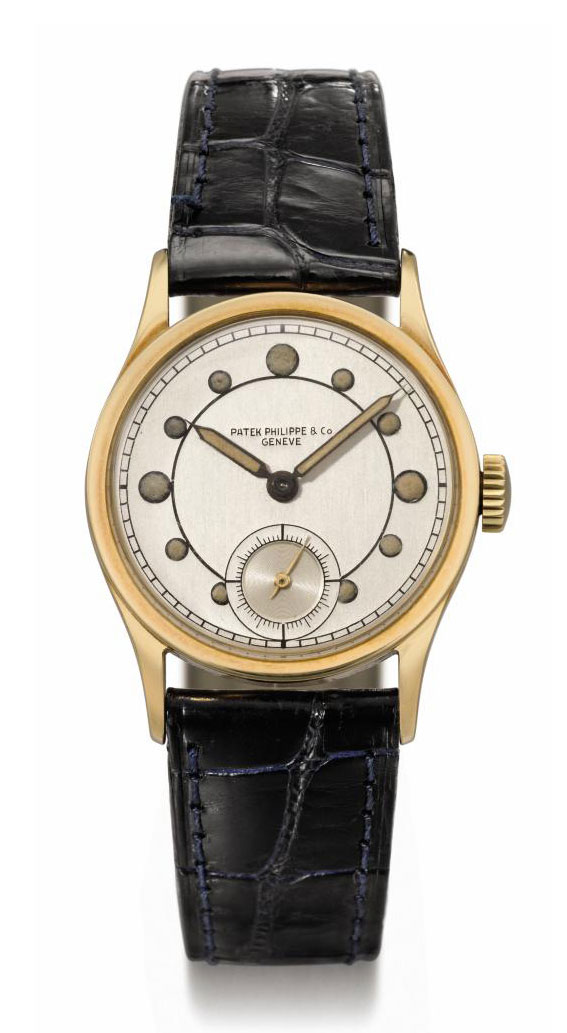 "Patek Philippe. A highly unusual and possibly unique 18K gold wristwatch with luminous ""telephone"" dial and original certificate"