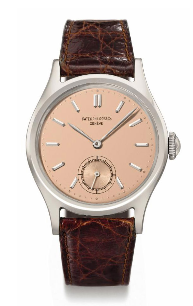 Patek Philippe. A fine and rare stainless steel wristwatch with rose-coloured dial
