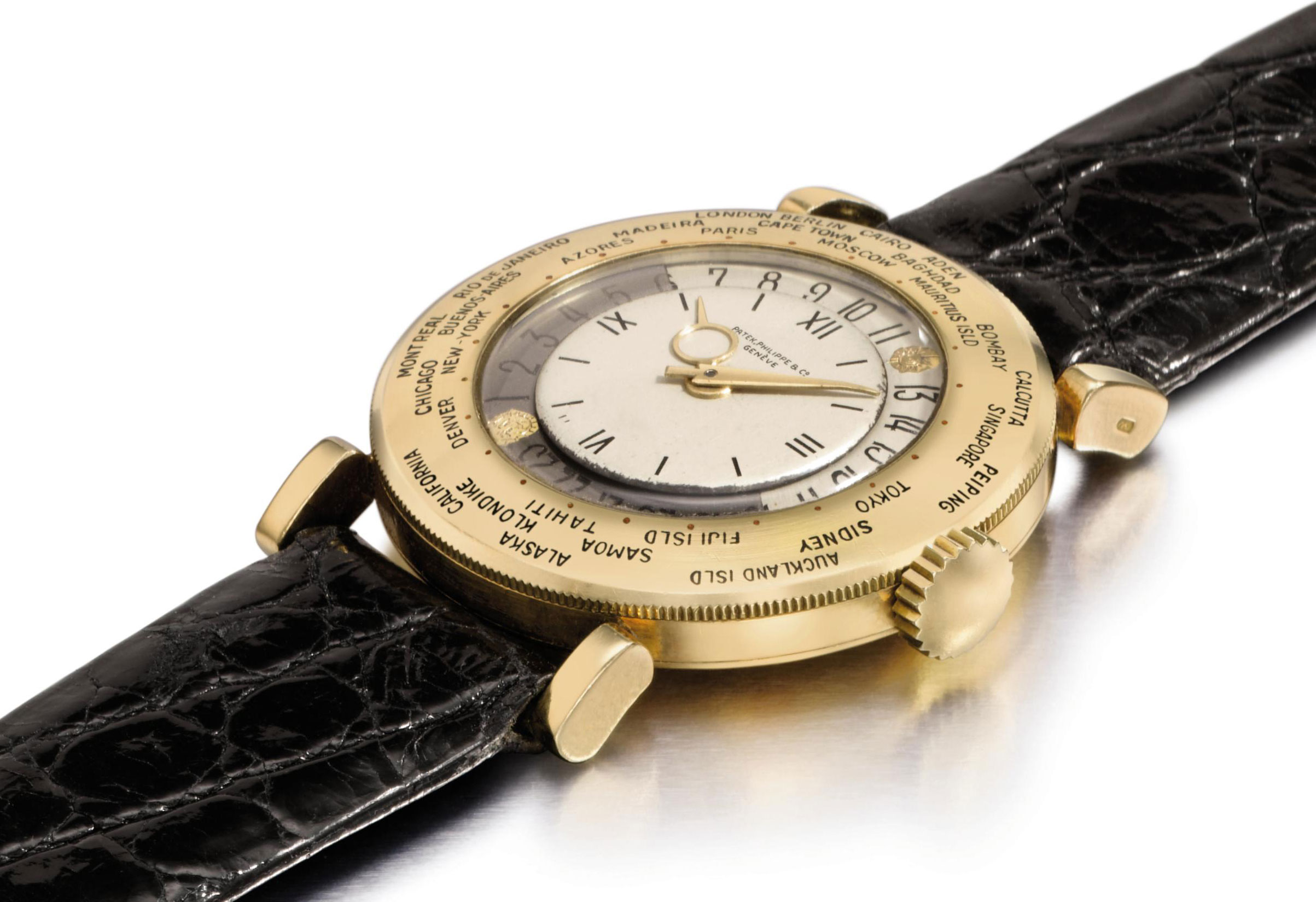 Patek Philippe. A fine and very rare 18K gold World Time wristwatch