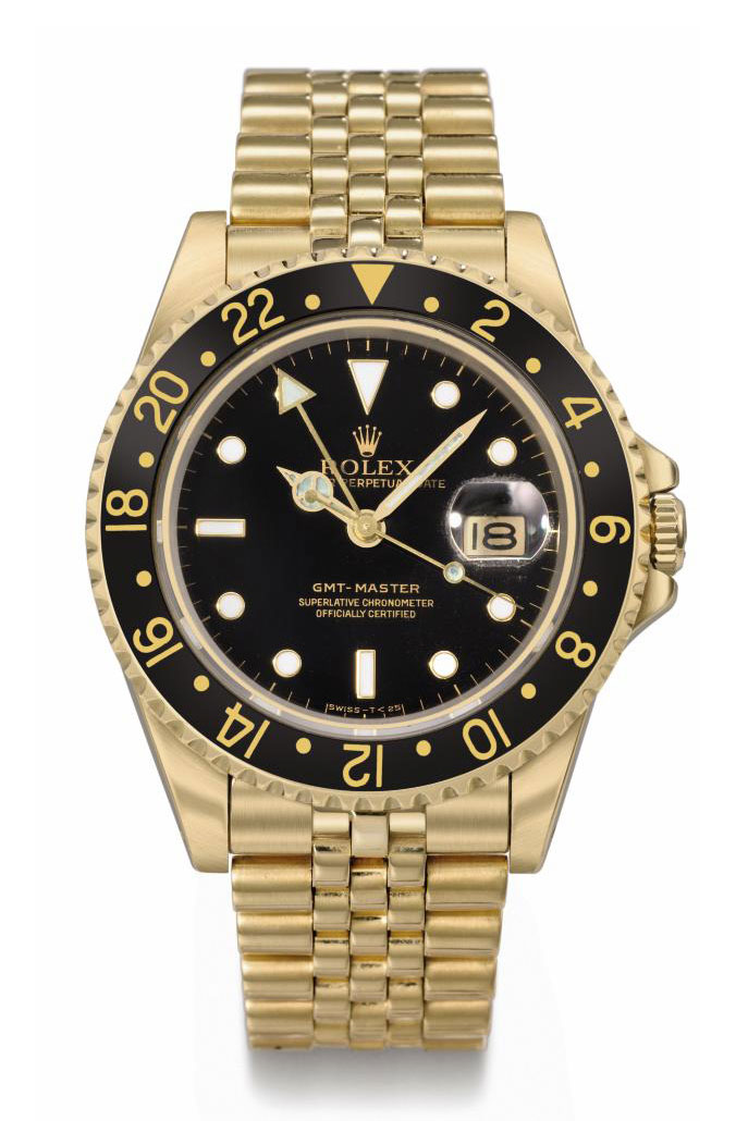 Rolex. An 18K gold automatic dual time wristwatch with sweep centre seconds, date and bracelet