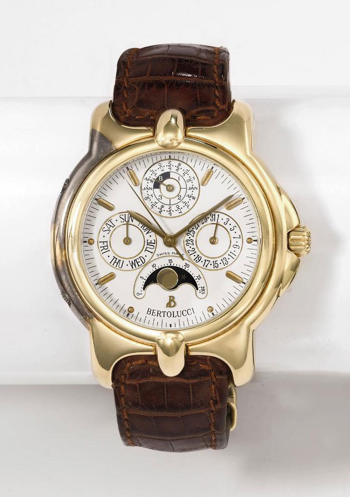 Bertolucci. A fine and large 18K gold tonneau-shaped automatic perpetual calendar wristwatch with moon phases