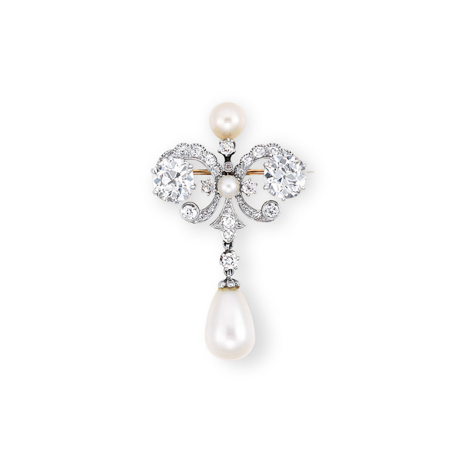 A DIAMOND AND PEARL BROOCH, BY MARCUS & CO.