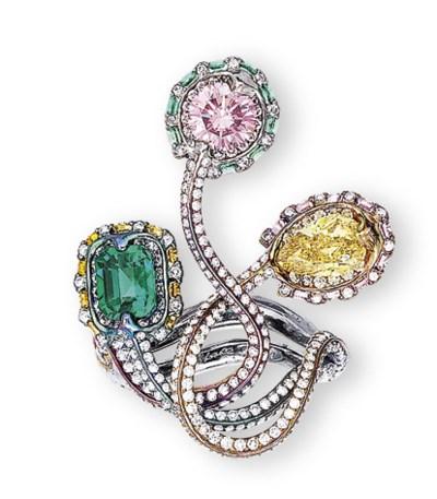 A COLOURED DIAMOND, EMERALD AN