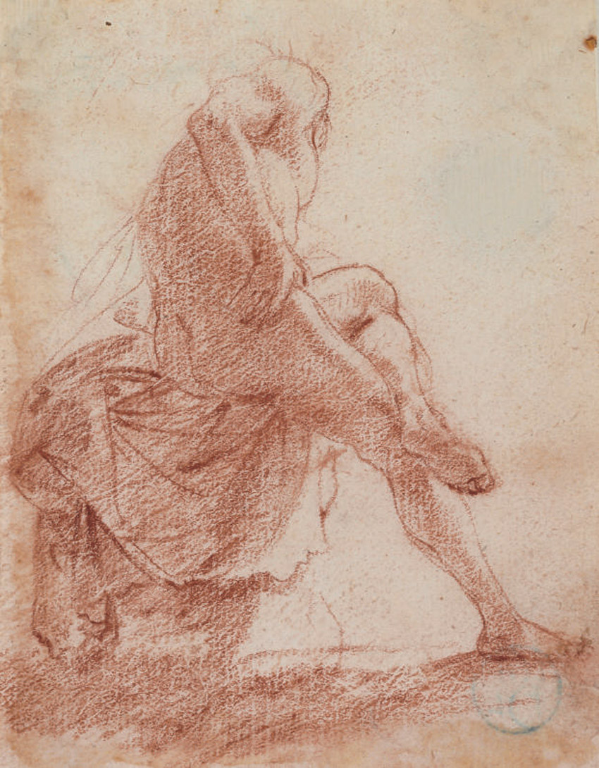 A seated male nude seen from behind