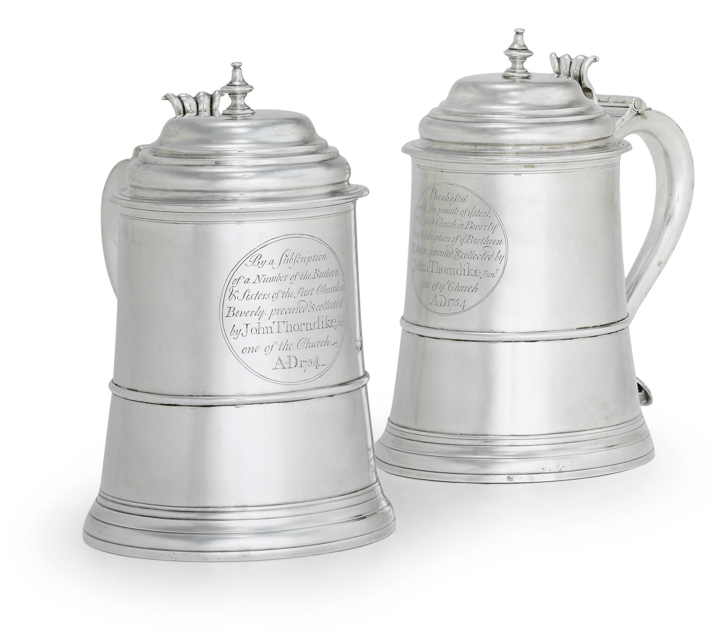 A PAIR OF SILVER TANKARDS