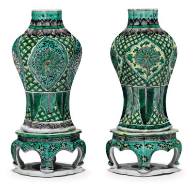 A PAIR OF BISCUIT-GLAZED VASES
