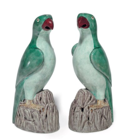 A PAIR OF GREEN-GLAZED PARROTS