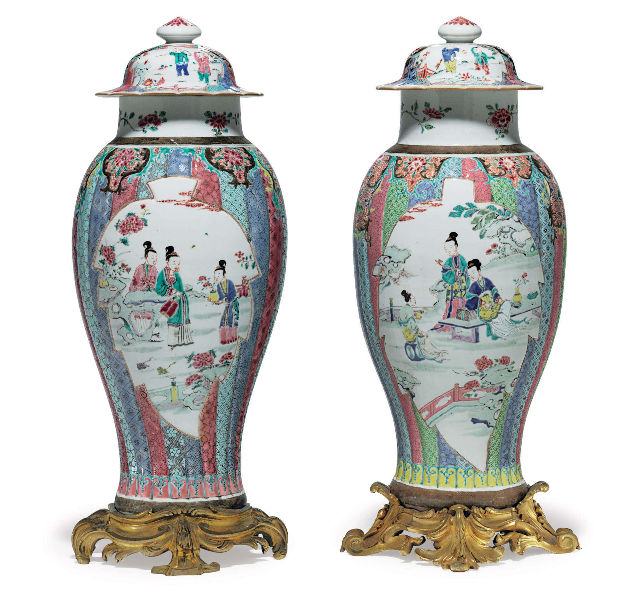 A LARGE PAIR OF FAMILLE ROSE BALUSTER VASES AND COVERS
