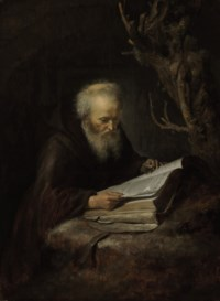 A hermit saint reading in a cave