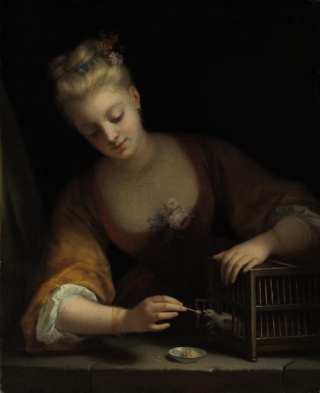 Jeune fille faisant manger des oiseaux