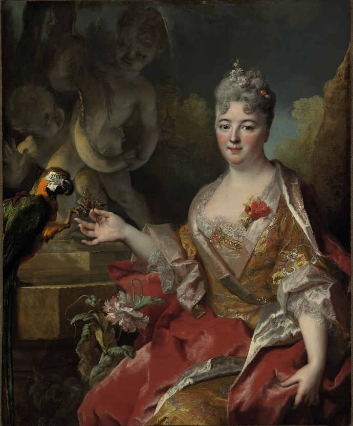 Portrait of a woman with a macaw